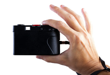 Travel concept. Hand making photo with old camera