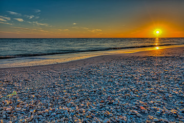 A sunset into the Gulf of Mexico from the beach on Sanibel Island, Florida. Wall mural