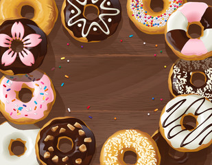 Mix of donuts on wooden background