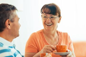 Senior couple enjoying and drinking coffee.
