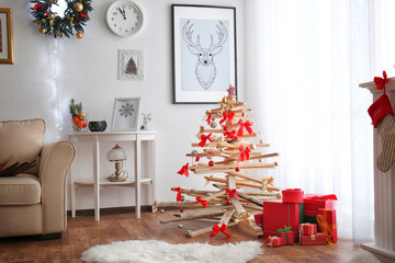 Creative Christmas tree in living room interior