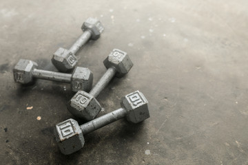Steel gray weights on gym floor