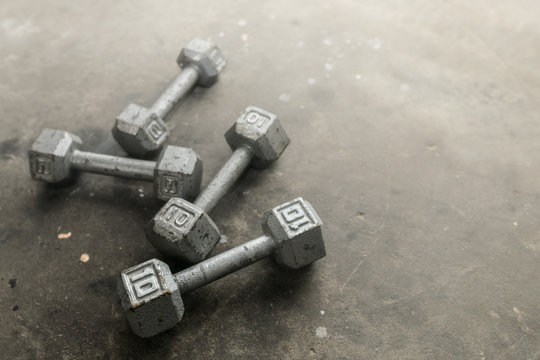 Steel gray weights on gym floor