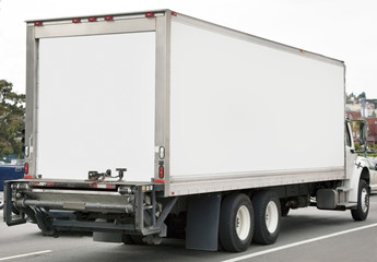Rear and side view of parked delivery truck. Horizontal.