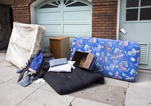 Abandoned home furnishings on sidewalk. Horizontal.