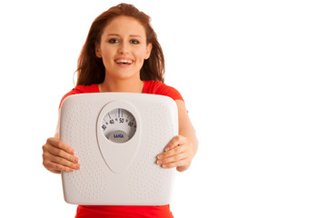 Woman with scale happy with her weight isolated over white backg