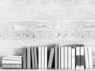 Black and white old books on a wooden shelf. 3D illustration