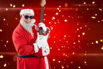 Composite image of smiling santa claus playing a guitar