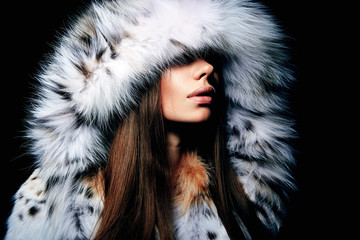 Luxury girl with long brown hair in a fur coat. The Snow Queen. Cold girl. Wall mural