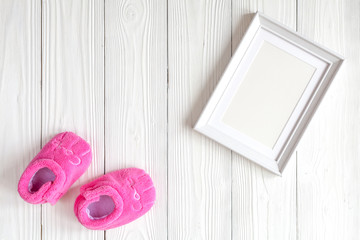 baby shower - blank picture frame on wooden background
