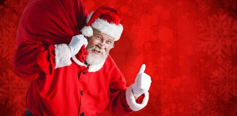 Composite image of portrait of santa claus holding christmas bag