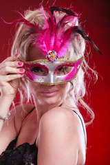Attractive woman wearing carnival mask.