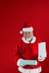 Composite image of santa claus opening gift box