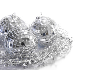 Silver mirror tile Christmas balls in a nest made of silver star wire garland