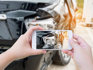 female hold mobile smartphone photographing car accident