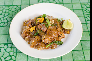Thai street food,Fried noodle with pork on dish