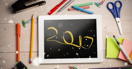 Composite image of digital image of new year written with tape m
