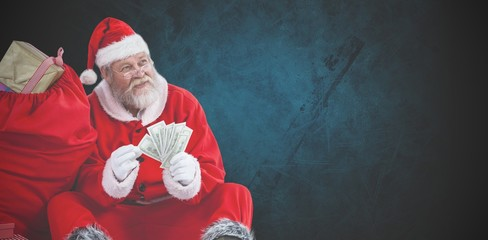 Composite image of santa claus sitting by sack full of gifts cou