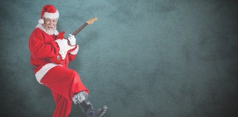 Composite image of cheerful santa claus playing guitar