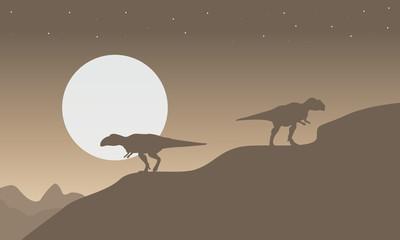 Silhouette of mapusaurus with big moon scenery