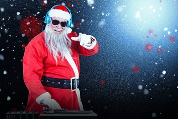 Composite image of santa claus playing sound mixer