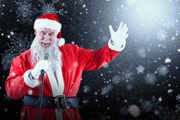 Composite image of portrait of santa claus singing christmas son