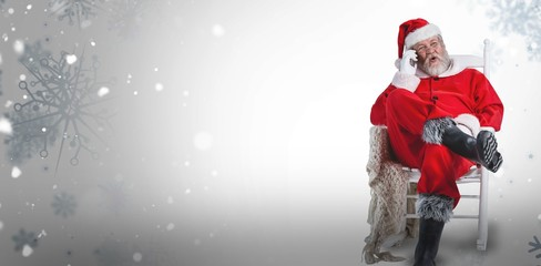 Composite image of excited santa claus talking on mobile phone