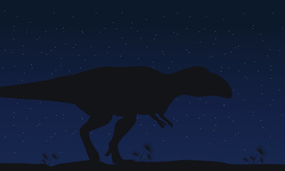 Silhouette of mapusaurus at night collection