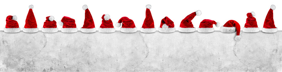 red white christmas santa hats on concrete wall empty billboard isolated on white background
