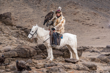 Thailand tourist in Mongolia traditionally riding horse with Kaz