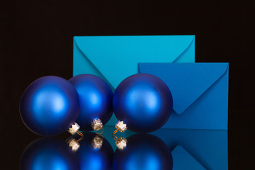 Blue envelopes and Christmas decoration on the glass table