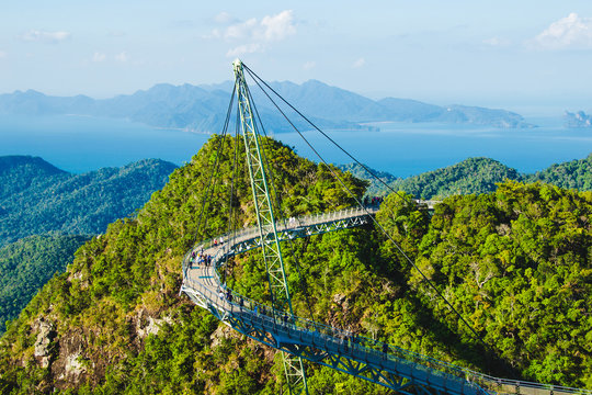 Breathtaking aerial view with Sky bridge, symbol Langkawi, Malaysia. Adventure holiday. Modern technology. Tourist attraction. Travel concept. Andaman sea backgroun