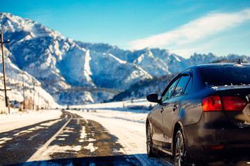 The brown car in the mountains the road.Extreme Winter Road Cond