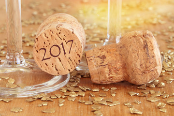 new year 2017 with champagne glasses and cork
