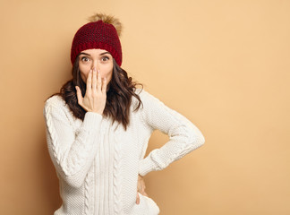 Young Beautiful Woman in winter clothes Surprised