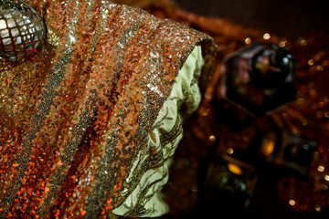 Sparkling golden cloth covers dinner table