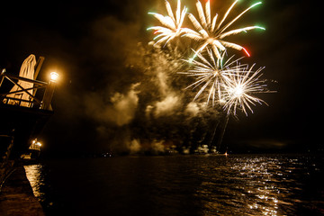 Fireworks shine over the water