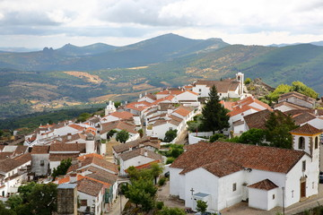 MARVAO, PORTUGAL: View of the fortified village and surrounding hills from the castle