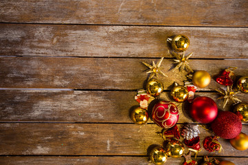 Shiny Christmas balls laying on a rustic table, ready to be hung