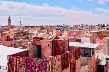 Carpets hanging from a roof in the Medina Marrakech
