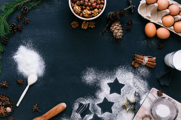 Top view composition of baking ingredients for Chrostmas cookies