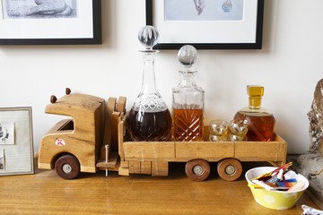Bottles of liquor in a wooden toy truck.