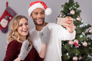 Happy nice couple taking selfies