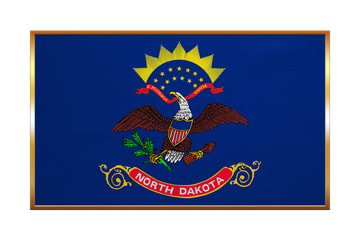 Flag of North Dakota, golden frame, fabric texture