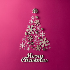 Christmas and New Years pink background with Christmas Tree made