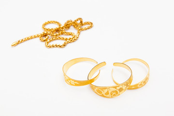 golden jewelry accessory on white backgrounds