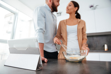 Smiling couple cooked in kitchen