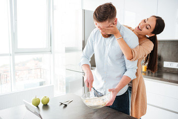 Funny couple cooked in kitchen
