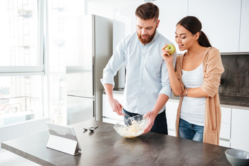 Young attractive couple at home kitchen