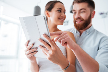 Couple in kitchen with tablet
